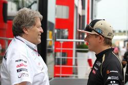 Norbert Haug, Mercedes Sporting Director with Kimi Raikkonen, Lotus F1 Team