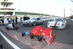 Overall race winners Alex Popow, Sébastien Bourdais, GT winners Andy Lally, John Potter kiss the yard of bricks
