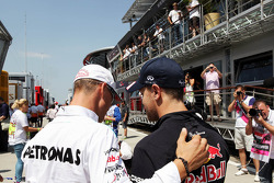 Michael Schumacher, Mercedes AMG F1 with Sebastian Vettel, Red Bull Racing