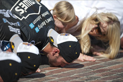 Race winner Jimmie Johnson, Hendrick Motorsports Chevrolet kisses the yard of bricks
