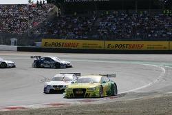 Mike Rockenfeller, Audi Sport Team Phoenix Racing Audi A5 DTM and Martin Tomczyk, BMW Team RMG BMW M3 DTM