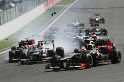 A crash at the start involving Lewis Hamilton, McLaren, Romain Grosjean, Lotus F1, Fernando Alonso, Ferrari, Kamui Kobayashi, Sauber