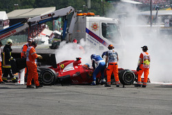 Fernando Alonso, Ferrari is helped from his car after a crash at the start