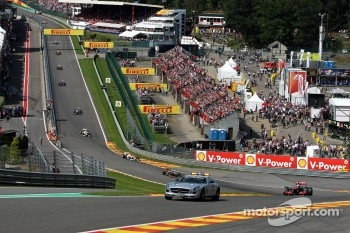The Safety car leads Jenson Button, McLaren Mercedes after the start crash