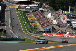 The Safety car leads Jenson Button, McLaren Mercedes after the start crash