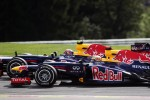 Mark Webber, Red Bull Racing and team mate Sebastian Vettel, Red Bull Racing battle for position