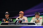 Post race FIA Press Conference, Red Bull Racing, second; Jenson Button, McLaren, race winner; Kimi Raikkonen, Lotus F1 Team, third