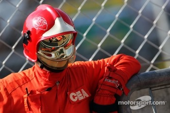 Timo Glock, Marussia F1 Team in the reflection of a marshall's visor