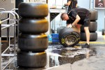 Lotus F1 Team wash their Pirelli tyres