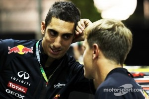 Sebastien Buemi talking with Sebastian Vettel