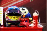 The helmet of Fernando Alonso, Ferrari and his mascot Tomita