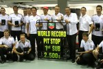 Photo shoot with McLaren Mercedes mechanics and Jenson Button, McLaren Mercedes to celebrate world record of the fastest pistop