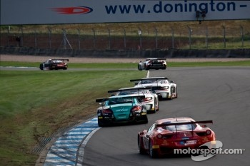 GT1 cars race under the bridge