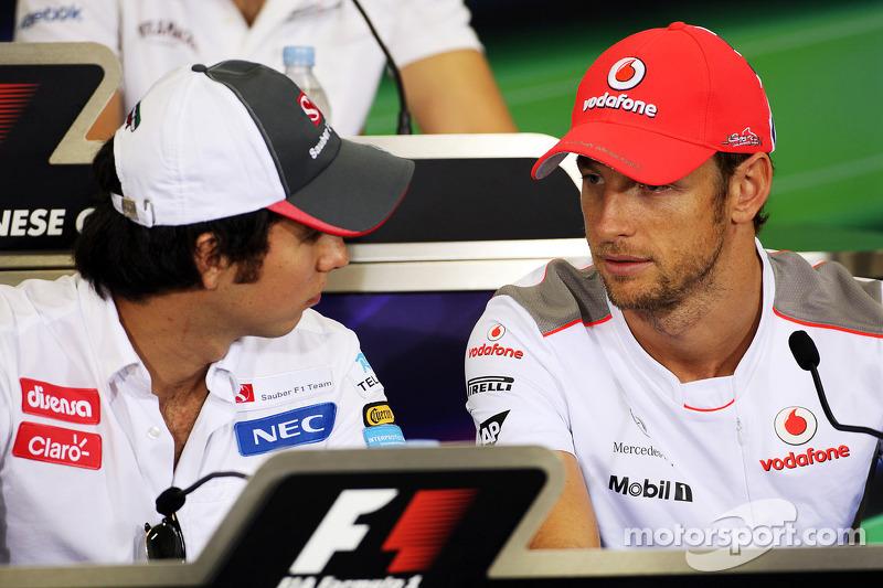 Sergio Perez, Sauber and Jenson Button, McLaren in the FIA Press Conference