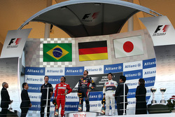 First place for Sebastian Vettel, Red Bull Racing second place for Felipe Massa, Scuderia Ferrari and third place for Kamui Kobayashi, Sauber F1 Team