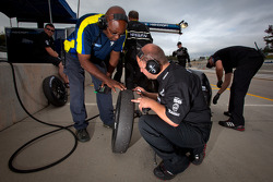 Michelin and Nissan Delta Wing technicians check a front tire of the #0 Nissan Delta Wing Delta Wing Project 56 Nissan