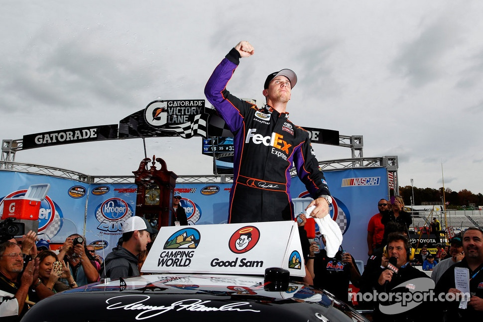Race winner Denny Hamlin celebrates