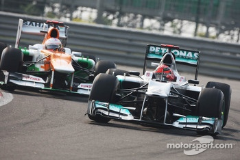 Michael Schumacher, Mercedes AMG F1 leads Paul di Resta, Sahara Force India