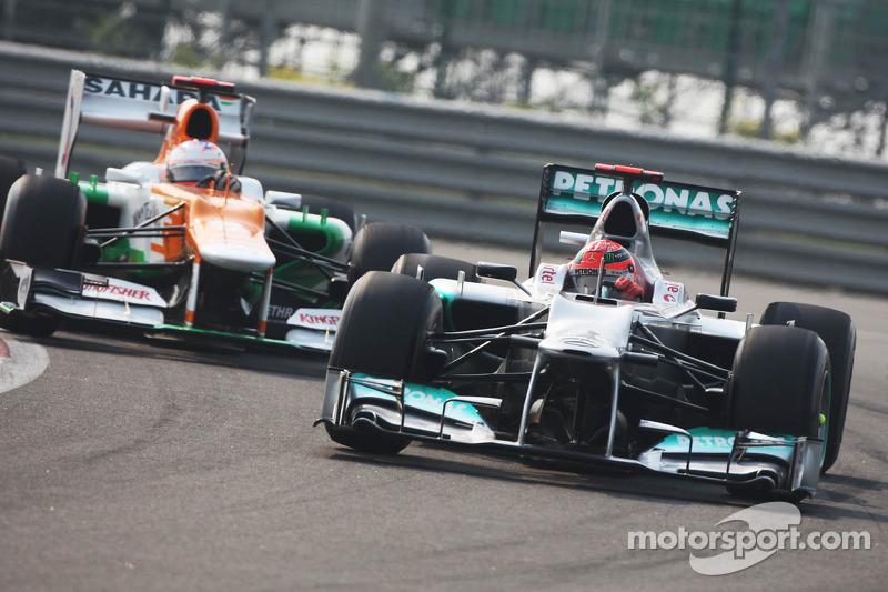 Michael Schumacher, Mercedes AMG F1 leads Paul di Resta, Sahara Force India