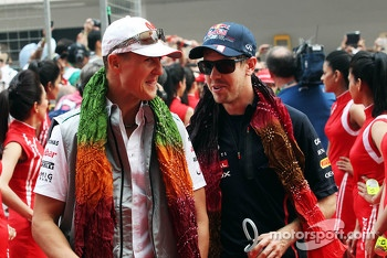 Michael Schumacher, Mercedes AMG F1 and Sebastian Vettel, Red Bull Racing on the drivers parade