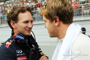 Christian Horner, Red Bull Racing Team Principal with Sebastian Vettel, Red Bull Racing on the grid