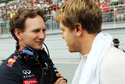 Christian Horner, Red Bull Racing Team Principal with Sebastian Vettel, Red Bull Racing on the grid