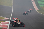 Romain Grosjean, Lotus F1 leads Jenson Button, McLaren