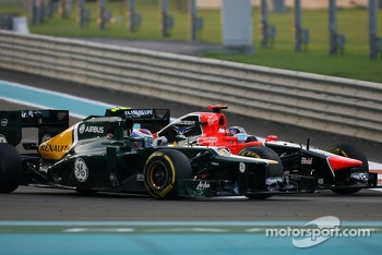 Vitaly Petrov, Caterham F1 Team and Timo Glock, Marussia F1 Team