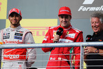 race winner Lewis Hamilton, McLaren with Fernando Alonso, Ferrari and Mario Andretti, on the podium