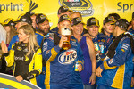 Championship victory lane: Penske Racing Dodge team members celebrate