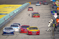 Sam Hornish Jr., Penske Racing Dodge and Mark Martin, Michael Waltrip Racing Toyota battle on pitlane