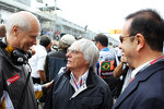 Bernie Ecclestone, CEO Formula One Group, with Carlos Ghosn, CEO Renault-Nissan on the grid