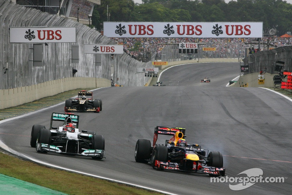 Michael Schumacher, Mercedes GP and Mark Webber, Red Bull Racing