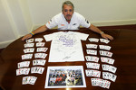 Mark Sutton of Suttom Images poses with signed memorabilia for Great Ormond Street Hospital charity
