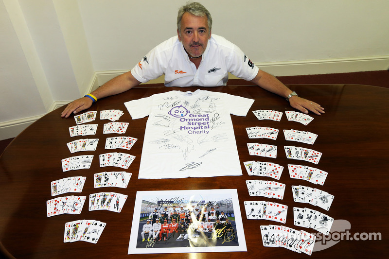 Mark Sutton of Sutton Images poses with signed memorabilia for Great Ormond Street Hospital charity
