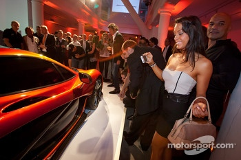 A charming guest takes photos of the McLaren P1