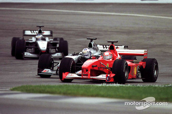Michael Schumacher passes David Coulthard