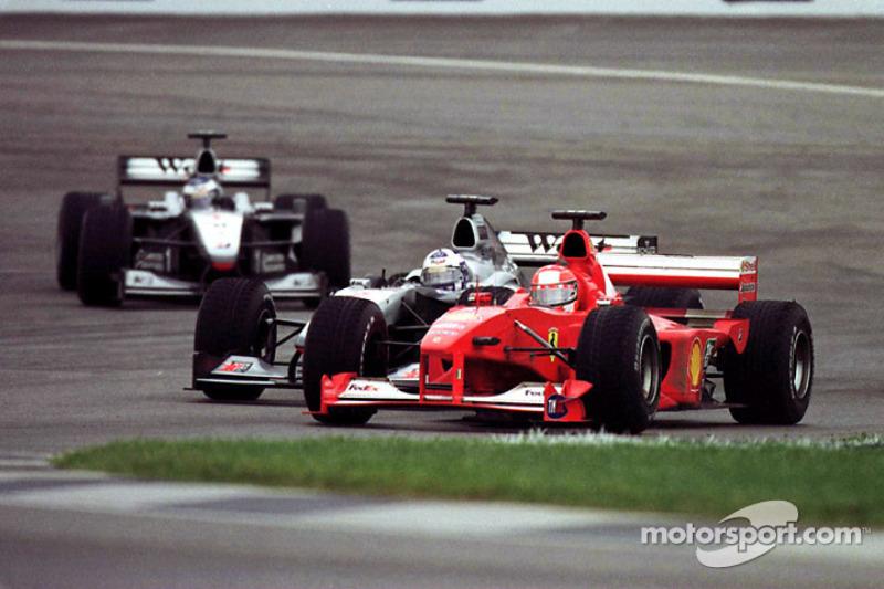 Michael Schumacher passes David Coulthard