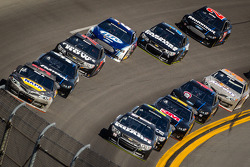 Dale Earnhardt Jr., Hendrick Motorsports Chevrolet and Martin Truex Jr., Michael Waltrip Racing Toyota lead a group of cars