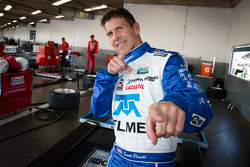 DP pole winner Scott Pruett celebrates