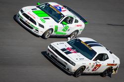 #87 Vehicle Technologies Dodge Challenger: Tony Ave, Jan Heylen, Doug Peterson, Moses Smith, #49 Roush Performance Mustang Boss 302R GT: Roly Falgueras, Bryan Ortiz