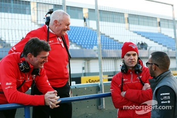 Graeme Lowdon, Marussia F1 Team Chief Executive Officer with John Booth, Marussia F1 Team Team Principal, Marc Hynes, Marussia F1 Team Driver Coach and Lewis Hamilton, Mercedes AMG F1