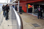 Photographers shoot into the Red Bull Racing pit garage