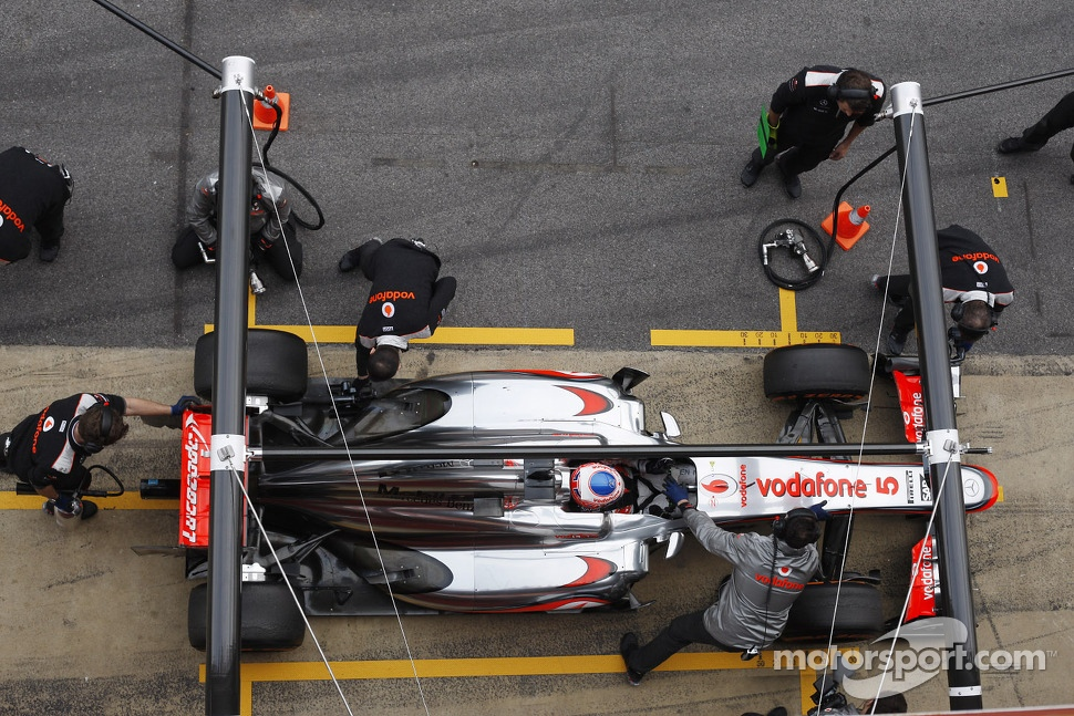 Jenson Button, McLaren MP4-28 in the pits