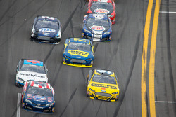 Bobby Labonte, JTG Daugherty Racing Toyota and Marcos Ambrose, Richard Petty Motorsports Ford battle