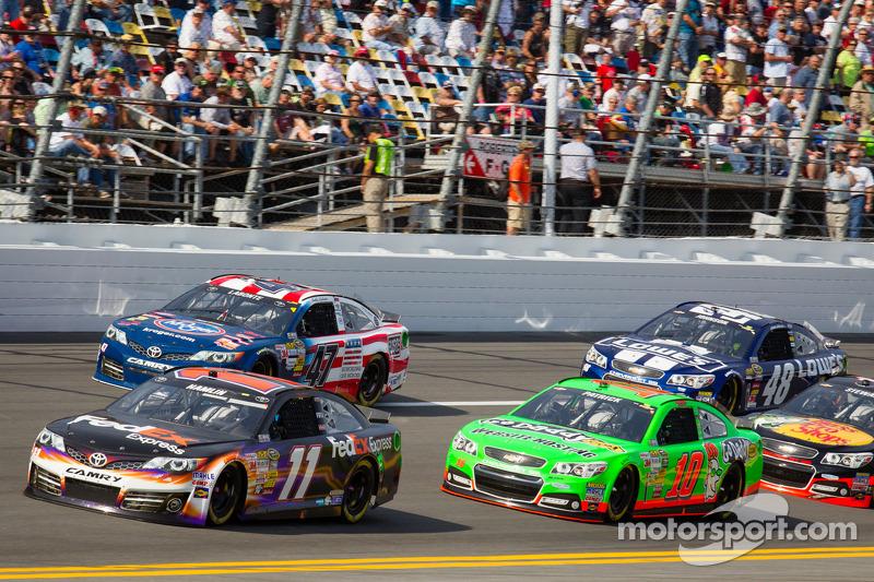 Denny Hamlin, Joe Gibbs Racing Toyota leads Danica Patrick, Stewart-Haas Racing Chevrolet