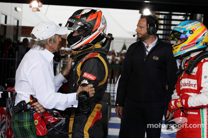 Race winner Kimi Raikkonen, Lotus F1 Team celebrates with Jackie Stewart, in parc ferme