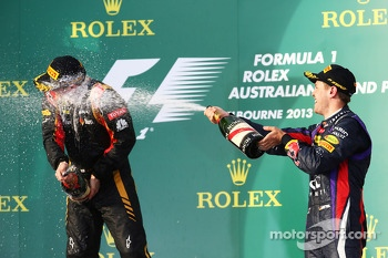 (L to R): Kimi Raikkonen, Lotus F1 Team and Sebastian Vettel, Red Bull Racing celebrate on the podium