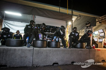 Paul Miller Racing team members ready for a pit stop