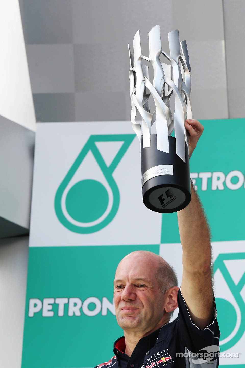 Adrian Newey, Red Bull Racing Chief Technical Officer celebrates on the podium